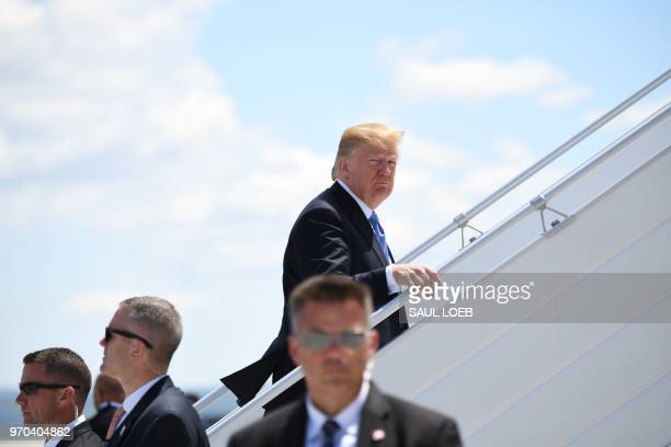 US President Donald Trump boards Air Force One prior to departure from Canadian Forces Base Bagotville in Canada June 9 2018 Trump travels to...