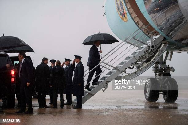 US President Donald Trump boards Air Force One under heavy rain at Andrews Air Force Base Maryland April 6 2017 Donald Trump will host Chinese...