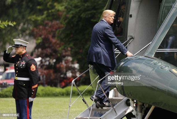 US President Donald Trump boards Marine One before departing to Camp David on the South Lawn of the White House in Washington DC US on Friday June 1...