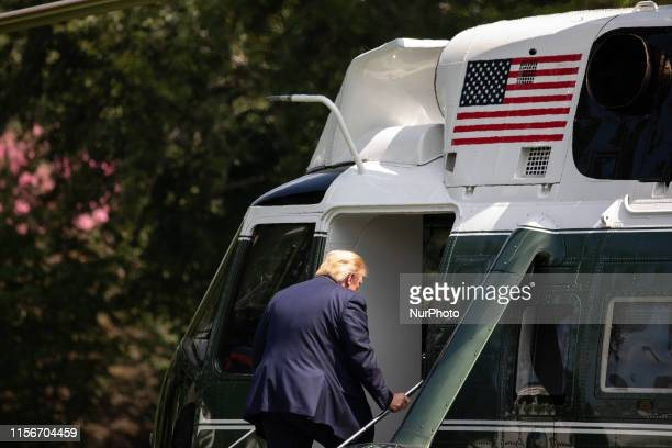 US President Donald Trump boards Marine One for departure from the South Lawn of the White House in Washington DC on Friday July 19 2019