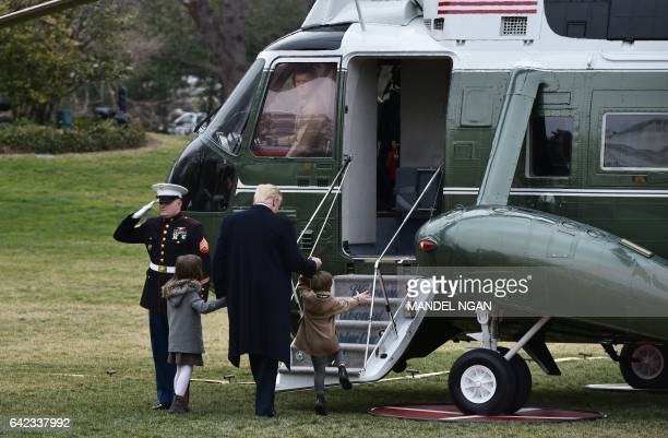 US President Donald Trump boards Marine One with grandchildren Arabella Kushner and Joseph Kushner on the South Lawn of the White House on February...