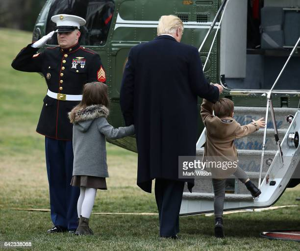 S President Donald Trump boards Marine One with his grandchildren Arabella and Joseph Kushner while departing from the White House on February 17...