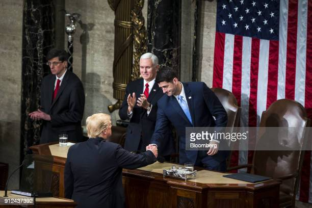 US President Donald Trump bottom greets US House Speaker Paul Ryan a Republican from Wisconsin right after delivering a State of the Union address to...