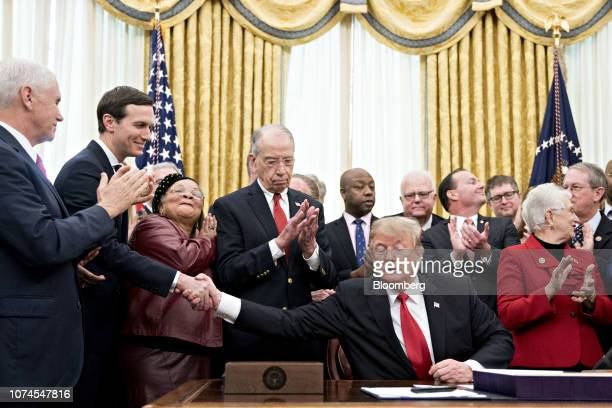 US President Donald Trump bottom right shakes hands with Jared Kushner senior White House adviser during a signing ceremony for S 756 First Step Act...
