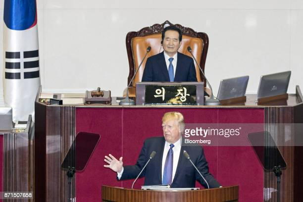 US President Donald Trump bottom speaks as Chung Syekyun speaker of the South Korean National Assembly looks on at the National Assembly in Seoul...
