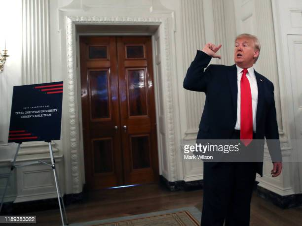 S President Donald Trump briefly speaks to the media after greeting sports teams in the State Dining Room during the NCAA Collegiate National...