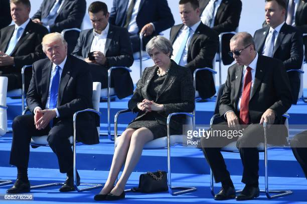 US President Donald Trump Britain's Prime Minister Theresa May and Turkish President Recep Tayyip Erdogan attend the NATO summit ceremony at the NATO...