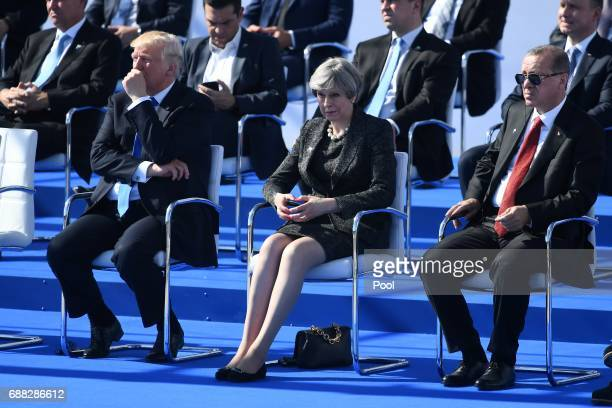 US President Donald Trump Britain's Prime Minister Theresa May and Turkish President Recep Tayyip Erdogan look on during the NATO summit ceremony at...