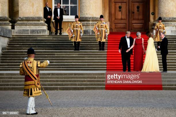 US President Donald Trump Britain's Prime Minister Theresa May US First Lady Melania Trump and Philip May take their position on the steps in the...