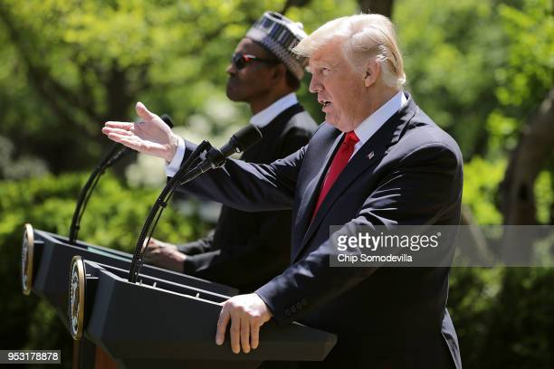 S President Donald Trump calls on a reporter during a joint news conference with Nigerian President Muhammadu Buhari in the Rose Garden of the White...
