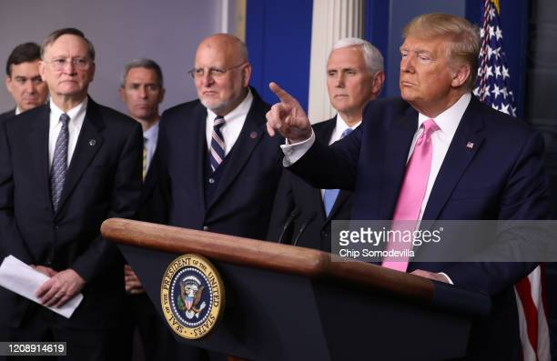 President Donald Trump calls on reporters at a news conference with members of his coronavirus task force, including Transportation Acting Under...