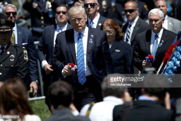 S President Donald Trump caries a flower to place on a memorial wreath after delivering remarks at the 36th annual National Peace Officers' Memorial...