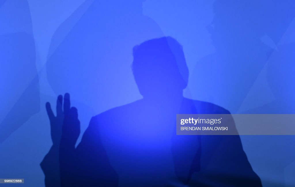 President Donald Trump casts a shadow as he addresses a press conference on the second day of the North Atlantic Treaty Organization (NATO) summit in Brussels on July 12, 2018.
