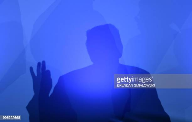 President Donald Trump casts a shadow as he addresses a press conference on the second day of the North Atlantic Treaty Organization summit in...