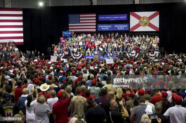 US President Donald Trump center addresses the crowd during a rally in Tampa Florida US on Tuesday July 31 2018 Iranian Foreign Minister Javad Zarif...