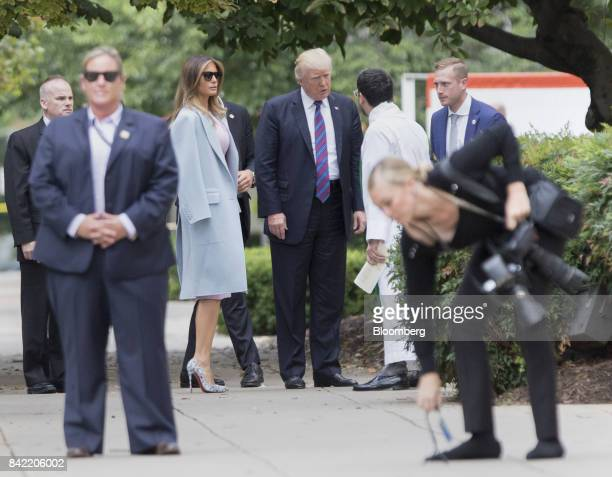 US President Donald Trump center and First Lady Melania Trump arrive at St John's Church on a national day of prayer for the people affected by...