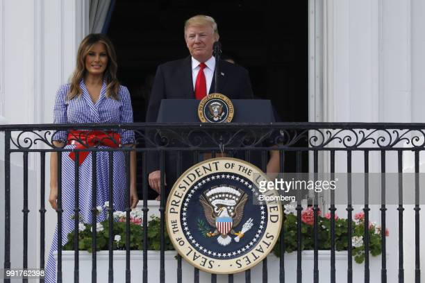 US President Donald Trump center and First Lady Melania Trump attend a picnic for military families in Washington DC US on Wednesday July 4 2018...