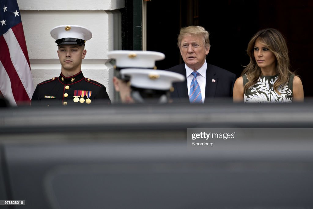 U.S. President Donald Trump, center, and First Lady Melania Trump walk out to greet Felipe VI, Spain's king, and Queen Letizia, not pictured, at the South Portico of the White House in Washington, D.C., U.S., on Tuesday, June 19, 2018. King Felipe and Queen Letizia are beginning a visit to the U.S., celebrating the 300th anniversaries of the founding of New Orleans and San Antonio. Photographer: Andrew Harrer/Bloomberg via Getty Images