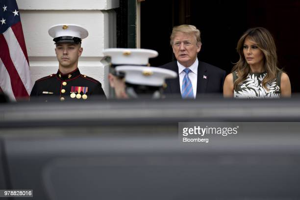 US President Donald Trump center and First Lady Melania Trump walk out to greet Felipe VI Spain's king and Queen Letizia not pictured at the South...