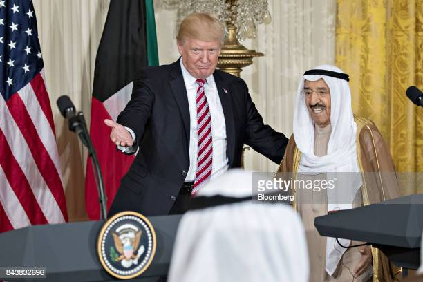US President Donald Trump center and Sheikh Sabah AlAhmed AlSabah Kuwait's emir arrive to a news conference in the East Room of the White House in...