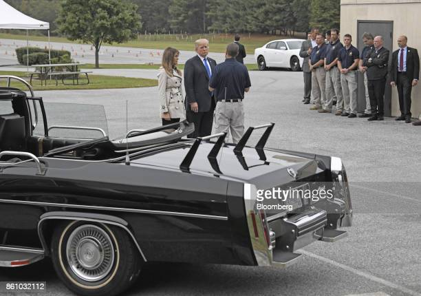 President Donald Trump, center, and U.S. First Lady Melania Trump speak with an employee while touring the U.S. Secret Service James J. Rowley...