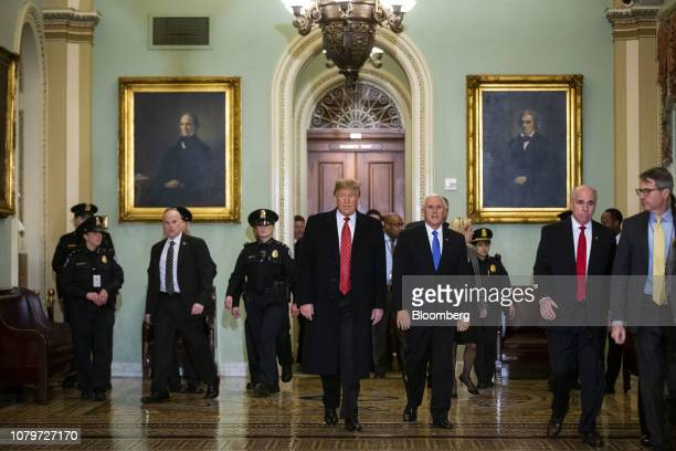 US President Donald Trump center and US Vice President Mike Pence center right arrive to a Senate Republicans policy luncheon at the US Capitol in...