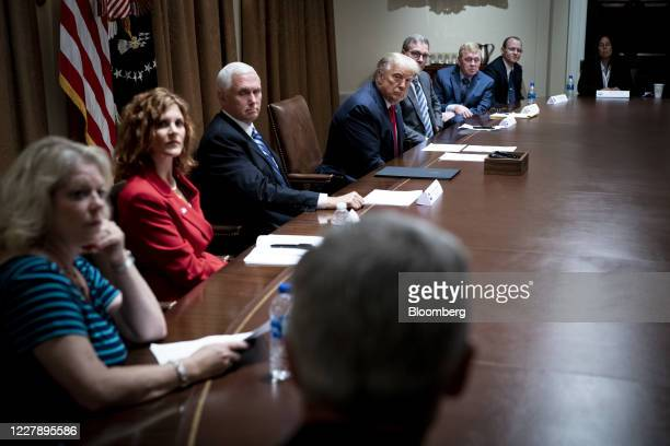 US President Donald Trump center and US Vice President Mike Pence center left sit during a meeting in the Cabinet Room of the White House in...