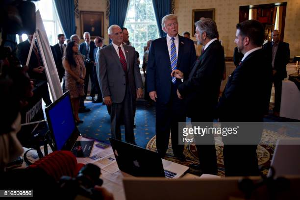 US President Donald Trump center and US Vice President Mike Pence center left participate in a Made in America event with companies from 50 states...