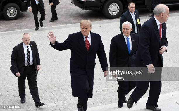 US President Donald Trump center and US Vice President Mike Pence second right arrive for a Senate Republicans policy luncheon at the US Capitol in...