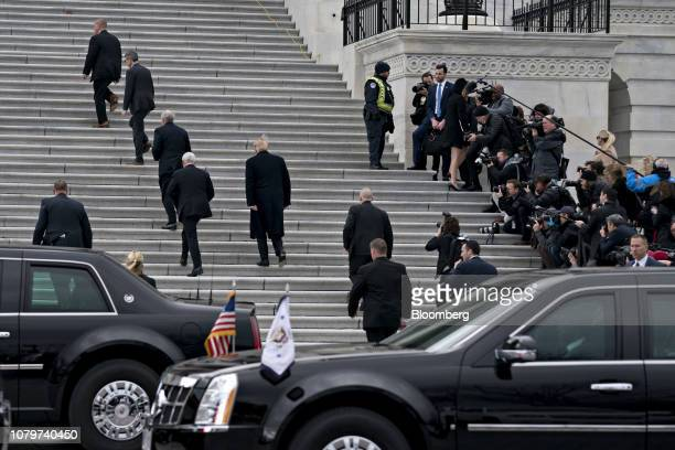 US President Donald Trump center and US Vice President Mike Pence second left arrive to the US Capitol for a meeting with Senate Republicans in...