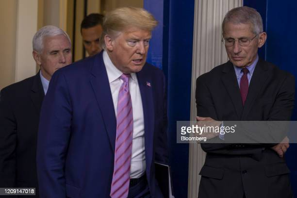 President Donald Trump, center, and Vice President Mike Pence, left, arrive past Anthony Fauci, director of the National Institute of Allergy and...