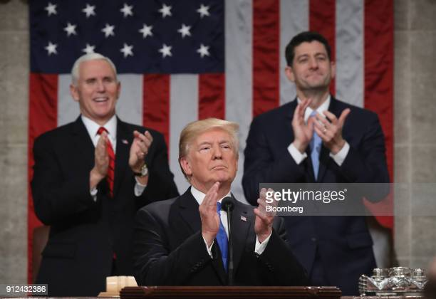 US President Donald Trump center applauds while delivering a State of the Union address to a joint session of Congress at the US Capitol in...