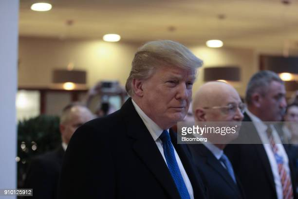 US President Donald Trump center arrives on day three of the World Economic Forum in Davos Switzerland on Thursday Jan 25 2018 World leaders...