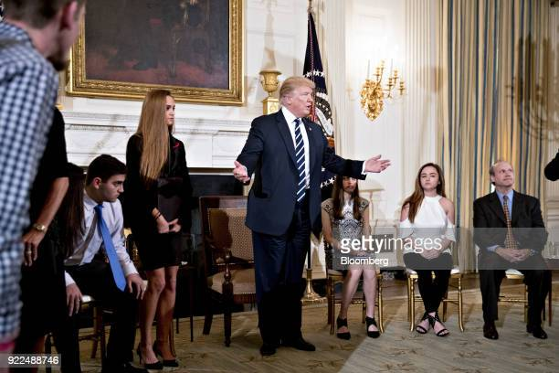 US President Donald Trump center arrives to a listening session on gun violence with high school students teachers and parents in the State Dining...