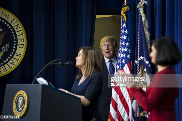 US President Donald Trump center arrives to speak at a 'Conversations with the Women of America' event at the Eisenhower Executive Office Building in...