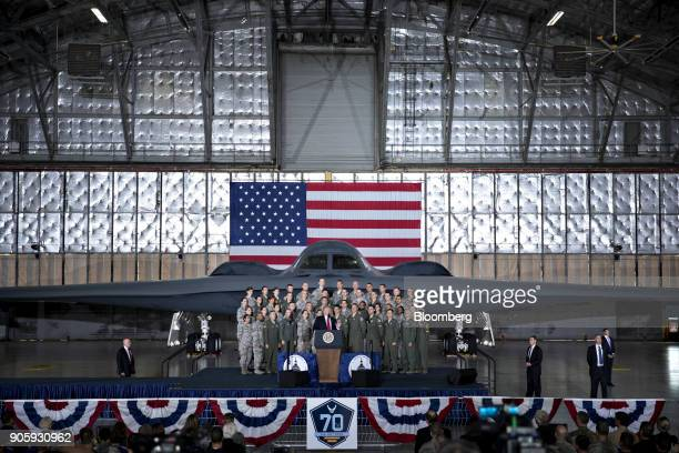 S President Donald Trump center delivers remarks to military personnel and families in an aircraft hangar at Joint Base Andrews Maryland US on Friday...