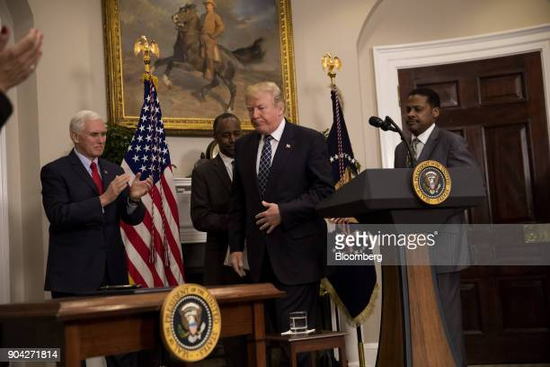 US President Donald Trump center finishes speaking while US Vice President Mike Pence from left Ben Carson US Secretary of Housing and Urban...