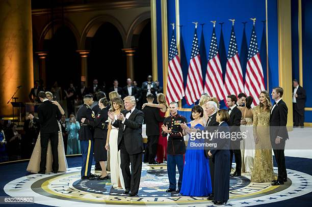 US President Donald Trump center First Lady Melania Trump center left Vice President Mike Pence second front right Second Lady Karen Pence third...