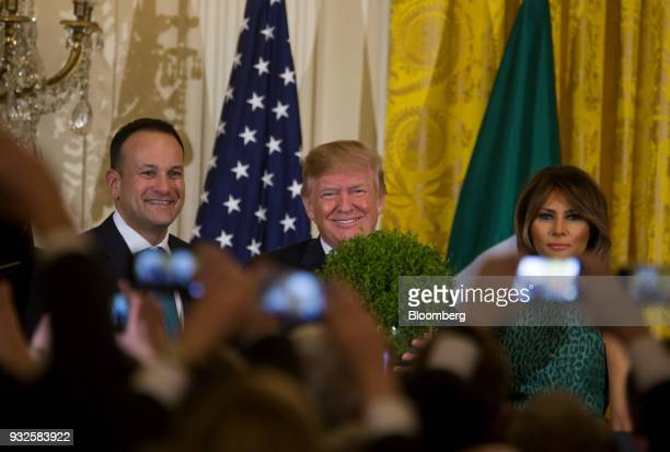 US President Donald Trump center First Lady Melania Trump right and Leo Varadkar Ireland's prime minister take part in the Shamrock Bowl Presentation...