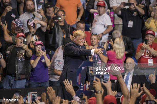 US President Donald Trump center gestures to the crowd as he arrives on stage at a rally in WilkesBarre Pennsylvania US on Thursday Aug 2 2018 Trump...