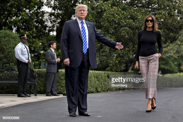 S President Donald Trump center gestures toward US First Lady Melania Trump before boarding Marine One on the South Lawn of the White House in...