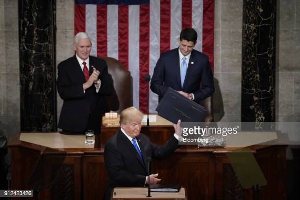 US President Donald Trump center gestures while arriving to deliver a State of the Union address to a joint session of Congress at the US Capitol in...