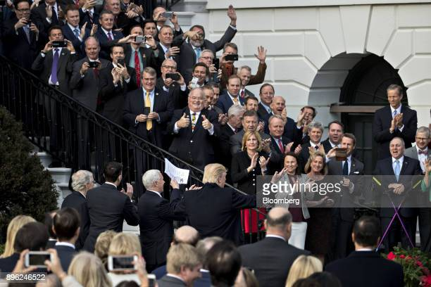 US President Donald Trump center gestures while arriving to speak at a tax bill passage event with Republican congressional members of the House and...