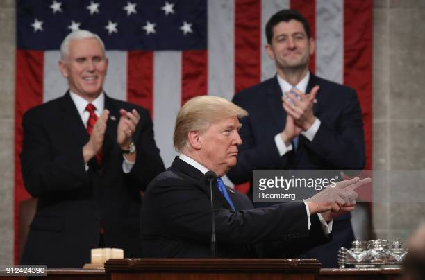 US President Donald Trump center gestures while delivering a State of the Union address to a joint session of Congress at the US Capitol in...