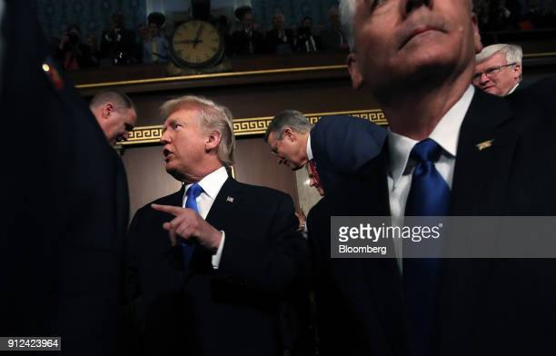 US President Donald Trump center greets attendees walking into the House Chamber to deliver a State of the Union address to a joint session of...