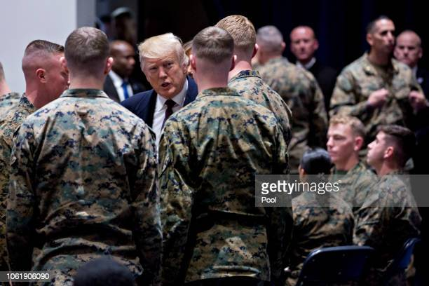 S President Donald Trump center greets Marines while visiting Marine Barracks on November 15 2018 in Washington DC President Trump and the First Lady...