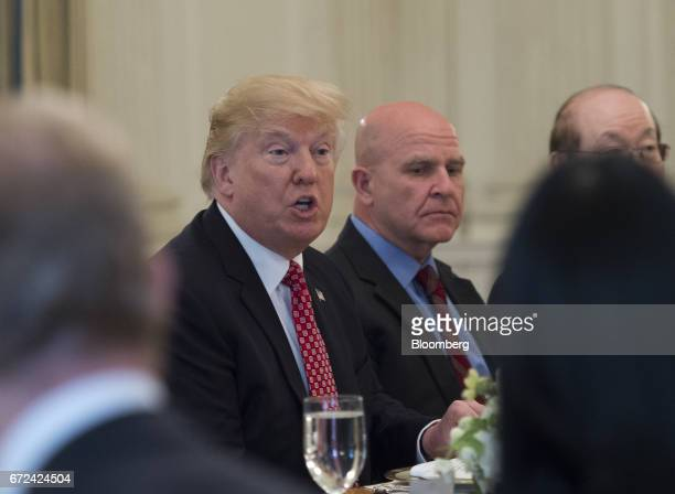 US President Donald Trump center hosts a working lunch with members of the UN Security Council inside the State Dining Room of the White House in...