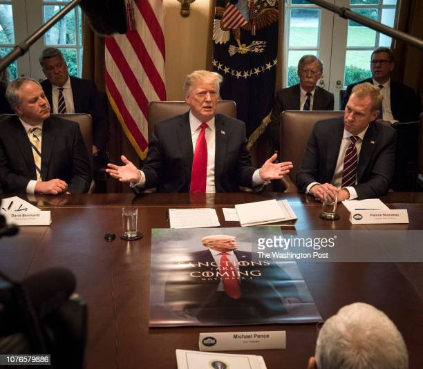 President Donald Trump center leads a meeting of his Cabinet with a poster featuring him spread out on the conference table on January 2019 in...