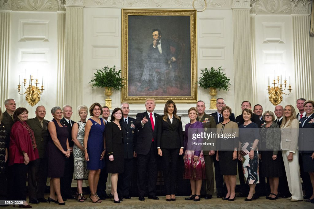 U.S. President Donald Trump, center left, and U.S. First Lady Melania Trump, center right, stand for an official photograph with senior military leaders and spouses in the State Dining room of the White House in Washington, D.C., U.S., on Thursday, Oct. 5, 2017. President Trump and the First Lady are hosting the group for dinner in the Blue Room of the White House. Photographer: Andrew Harrer/Bloomberg via Getty Images