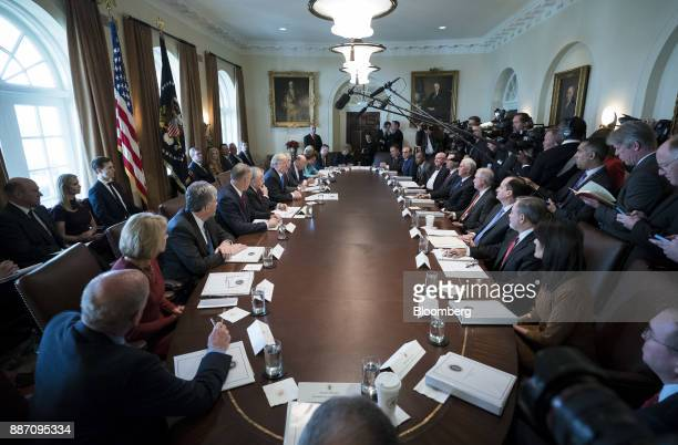 President Donald Trump, center left, speaks during a cabinet meeting at the White House in Washington, D.C., U.S., on Wednesday, Dec. 6, 2017....